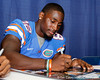 Florida redshirt junior receiver Omarius Hines signs an autograph during the Gators' annual Fan Day event on Saturday, August 20, 2011 at the Stephen C. O'Connell Center in Gainesville, Fla. / Gator Country photo by Tim Casey