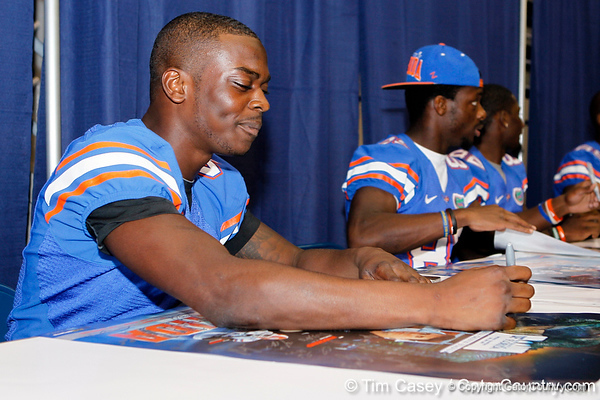 Florida redshirt sophomore receiver Andre Debose signs an autograph during the Gators' annual Fan Day event on Saturday, August 20, 2011 at the Stephen C. O'Connell Center in Gainesville, Fla. / Gator Country photo by Tim Casey