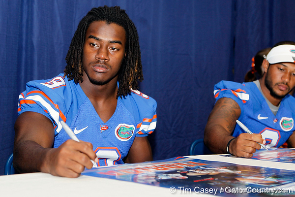 Florida redshirt freshman safety Josh Shaw signs an autograph during the Gators' annual Fan Day event on Saturday, August 20, 2011 at the Stephen C. O'Connell Center in Gainesville, Fla. / Gator Country photo by Tim Casey