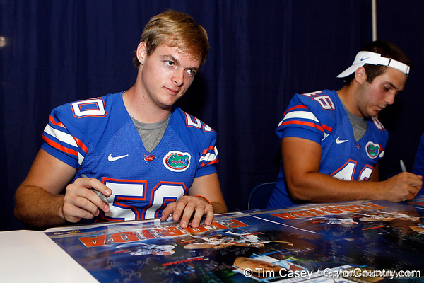 Florida senior longsnapper Cody Hampton signs an autograph during the Gators' annual Fan Day event on Saturday, August 20, 2011 at the Stephen C. O'Connell Center in Gainesville, Fla. / Gator Country photo by Tim Casey