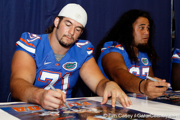 Florida redshirt junior tackle Matt Patchan signs an autograph during the Gators' annual Fan Day event on Saturday, August 20, 2011 at the Stephen C. O'Connell Center in Gainesville, Fla. / Gator Country photo by Tim Casey