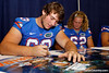 Florida freshman guard Trip Thurman signs an autograph during the Gators' annual Fan Day event on Saturday, August 20, 2011 at the Stephen C. O'Connell Center in Gainesville, Fla. / Gator Country photo by Tim Casey