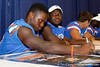 Florida freshman linebacker Chris Johnson signs an autograph during the Gators' annual Fan Day event on Saturday, August 20, 2011 at the Stephen C. O'Connell Center in Gainesville, Fla. / Gator Country photo by Tim Casey