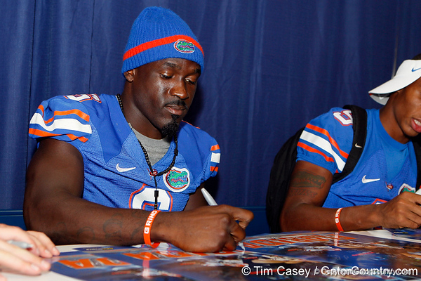 Florida redshirt senior receiver Deonte Thompson signs an autograph during the Gators' annual Fan Day event on Saturday, August 20, 2011 at the Stephen C. O'Connell Center in Gainesville, Fla. / Gator Country photo by Tim Casey