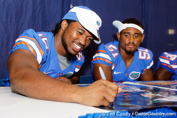 Florida sophomore linebacker Darrin Kitchens signs an autograph during the Gators' annual Fan Day event on Saturday, August 20, 2011 at the Stephen C. O'Connell Center in Gainesville, Fla. / Gator Country photo by Tim Casey