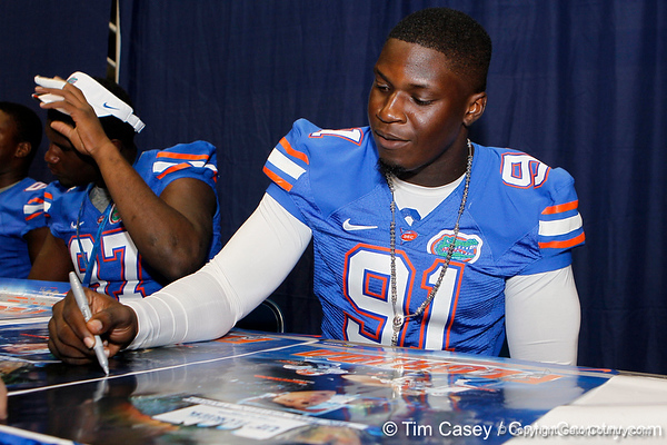 Florida redshirt junior defensive end Earl Okine signs an autograph during the Gators' annual Fan Day event on Saturday, August 20, 2011 at the Stephen C. O'Connell Center in Gainesville, Fla. / Gator Country photo by Tim Casey