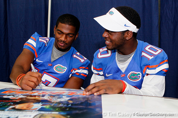 Florida freshman quarterback Jacoby Brissett and redshirt freshman quarterback Tyler Murphy sign autographs during the Gators' annual Fan Day event on Saturday, August 20, 2011 at the Stephen C. O'Connell Center in Gainesville, Fla. / Gator Country photo by Tim Casey