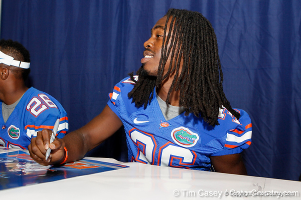 Florida redshirt senior cornerback Moses Jenkins signs an autograph during the Gators' annual Fan Day event on Saturday, August 20, 2011 at the Stephen C. O'Connell Center in Gainesville, Fla. / Gator Country photo by Tim Casey