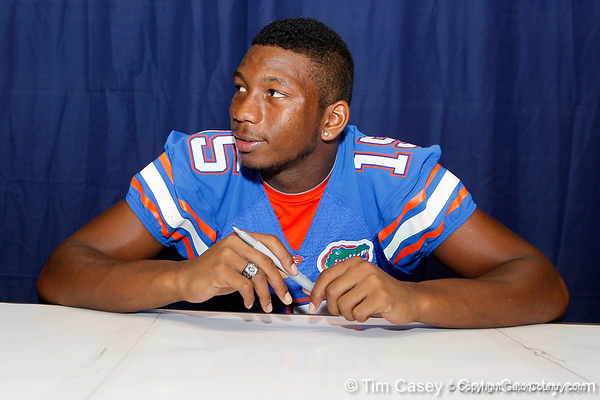 Florida freshman cornerback Loucheiz Purifoy talks with a fan during the Gators' annual Fan Day event on Saturday, August 20, 2011 at the Stephen C. O'Connell Center in Gainesville, Fla. / Gator Country photo by Tim Casey