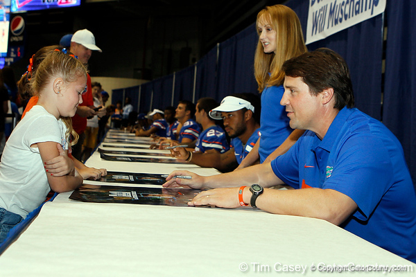 Florida head coach Will Muschamp talks with a fan during the Gators' annual Fan Day event on Saturday, August 20, 2011 at the Stephen C. O'Connell Center in Gainesville, Fla. / Gator Country photo by Tim Casey