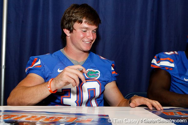 Florida freshman receiver Michael McNeely signs an autograph during the Gators' annual Fan Day event on Saturday, August 20, 2011 at the Stephen C. O'Connell Center in Gainesville, Fla. / Gator Country photo by Tim Casey