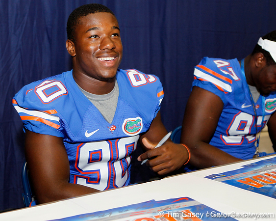 Florida freshman defensive end Evan Holmes talks with a fan during the Gators' annual Fan Day event on Saturday, August 20, 2011 at the Stephen C. O'Connell Center in Gainesville, Fla. / Gator Country photo by Tim Casey