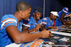 Florida freshman cornerback Marcus Roberson and freshman safety Jabari Gorman sign autographs during the Gators' annual Fan Day event on Saturday, August 20, 2011 at the Stephen C. O'Connell Center in Gainesville, Fla. / Gator Country photo by Tim Casey