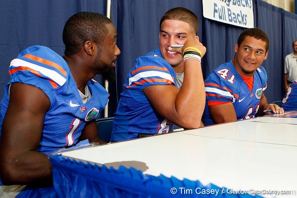 Florida redshirt senior running back Chris Rainey, sophomore running back Trey Burton and freshman fullback Hunter Joyer talk during the Gators' annual Fan Day event on Saturday, August 20, 2011 at the Stephen C. O'Connell Center in Gainesville, Fla. / Gator Country photo by Tim Casey