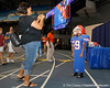 A child tries on a helmet and shoulder pads during the Gators' annual Fan Day event on Saturday, August 20, 2011 at the Stephen C. O'Connell Center in Gainesville, Fla. / Gator Country photo by Tim Casey