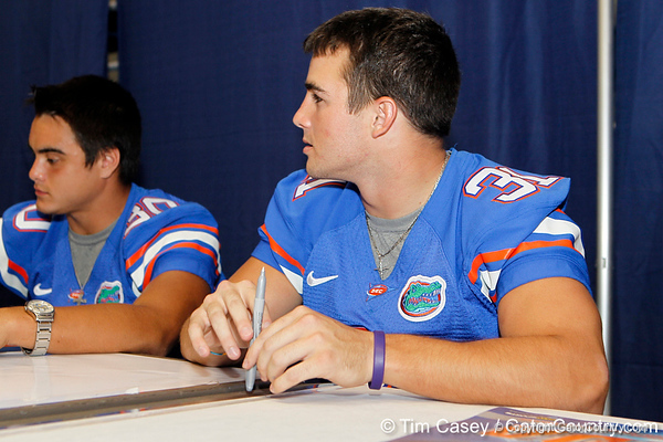 Florida senior cornerback Brian Biada signs an autograph during the Gators' annual Fan Day event on Saturday, August 20, 2011 at the Stephen C. O'Connell Center in Gainesville, Fla. / Gator Country photo by Tim Casey