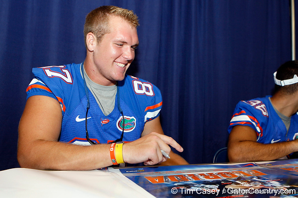 Florida senior tight end William Steinmann signs an autograph during the Gators' annual Fan Day event on Saturday, August 20, 2011 at the Stephen C. O'Connell Center in Gainesville, Fla. / Gator Country photo by Tim Casey