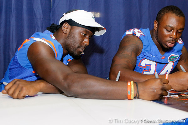 Florida junior linebacker Dee Finley signs an autograph during the Gators' annual Fan Day event on Saturday, August 20, 2011 at the Stephen C. O'Connell Center in Gainesville, Fla. / Gator Country photo by Tim Casey