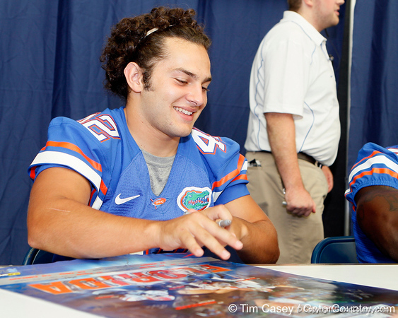 Florida freshman running back Blake Castillo signs an autograph during the Gators' annual Fan Day event on Saturday, August 20, 2011 at the Stephen C. O'Connell Center in Gainesville, Fla. / Gator Country photo by Tim Casey