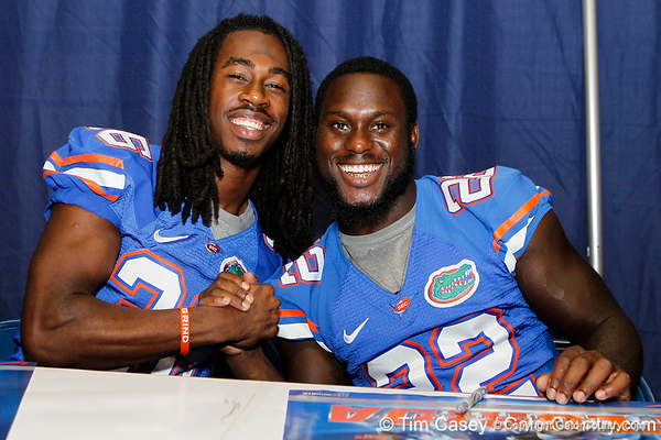 Florida redshirt senior cornerback Moses Jenkins and sophomore safety Matt Elam pose for a photo during the Gators' annual Fan Day event on Saturday, August 20, 2011 at the Stephen C. O'Connell Center in Gainesville, Fla. / Gator Country photo by Tim Casey