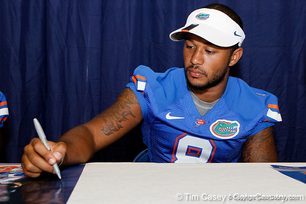 Florida redshirt junior cornerback Jeremy Brown signs an autograph during the Gators' annual Fan Day event on Saturday, August 20, 2011 at the Stephen C. O'Connell Center in Gainesville, Fla. / Gator Country photo by Tim Casey