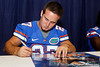 Florida freshman safety Ben Peacock signs an autograph during the Gators' annual Fan Day event on Saturday, August 20, 2011 at the Stephen C. O'Connell Center in Gainesville, Fla. / Gator Country photo by Tim Casey