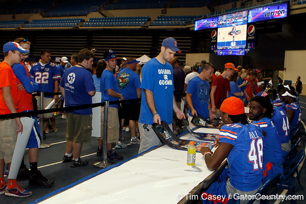 Florida sophomore linebacker Neiron Ball signs an autograph during the Gators' annual Fan Day event on Saturday, August 20, 2011 at the Stephen C. O'Connell Center in Gainesville, Fla. / Gator Country photo by Tim Casey