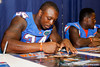 Florida redshirt junior defensive end Lerentee McCray signs an autograph during the Gators' annual Fan Day event on Saturday, August 20, 2011 at the Stephen C. O'Connell Center in Gainesville, Fla. / Gator Country photo by Tim Casey