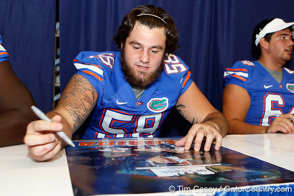 Florida redshirt sophomore center Nick Alajajian signs an autograph during the Gators' annual Fan Day event on Saturday, August 20, 2011 at the Stephen C. O'Connell Center in Gainesville, Fla. / Gator Country photo by Tim Casey