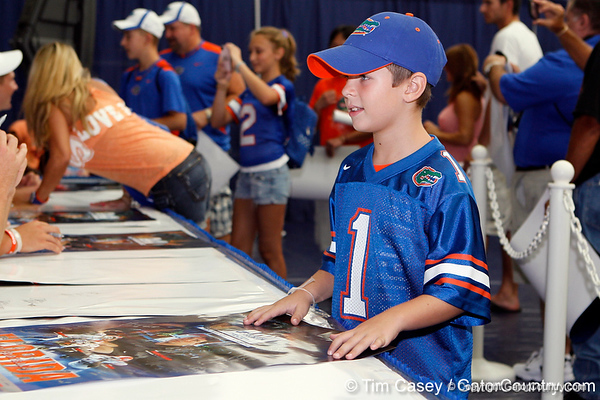 A fan asks for an autograph during the Gators' annual Fan Day event on Saturday, August 20, 2011 at the Stephen C. O'Connell Center in Gainesville, Fla. / Gator Country photo by Tim Casey