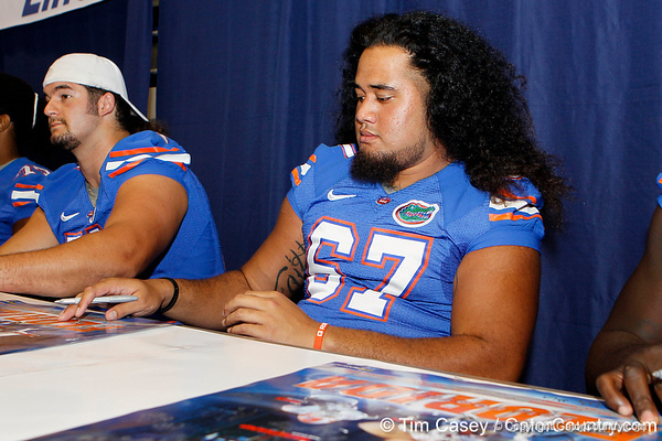 Florida redshirt sophomore guard Jon Halapio signs an autograph during the Gators' annual Fan Day event on Saturday, August 20, 2011 at the Stephen C. O'Connell Center in Gainesville, Fla. / Gator Country photo by Tim Casey