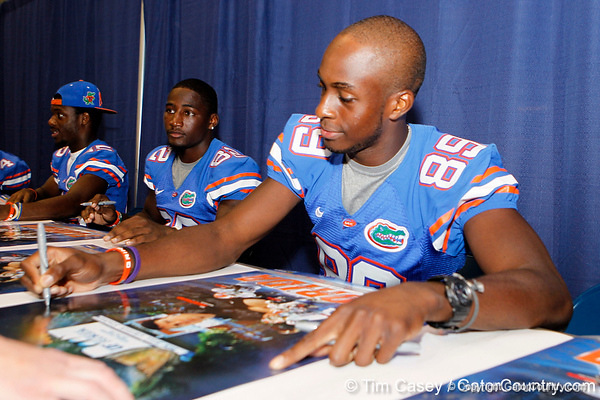 Florida redshirt sophomore receiver Stephen Alli signs an autograph during the Gators' annual Fan Day event on Saturday, August 20, 2011 at the Stephen C. O'Connell Center in Gainesville, Fla. / Gator Country photo by Tim Casey