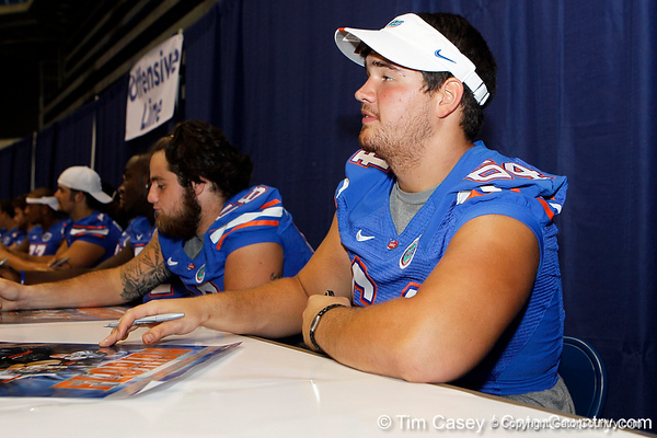 Florida redshirt sophomore tackle Kyle Koehne signs an autograph during the Gators' annual Fan Day event on Saturday, August 20, 2011 at the Stephen C. O'Connell Center in Gainesville, Fla. / Gator Country photo by Tim Casey