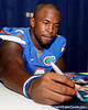 Florida redshirt sophomore linebacker Jelani Jenkins signs an autograph during the Gators' annual Fan Day event on Saturday, August 20, 2011 at the Stephen C. O'Connell Center in Gainesville, Fla. / Gator Country photo by Tim Casey