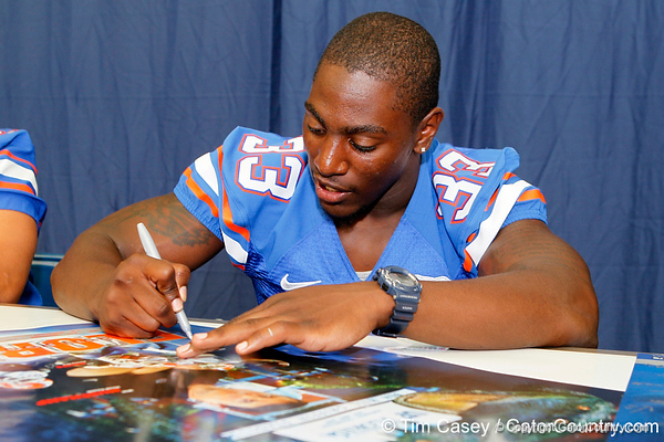 Florida redshirt freshman running back Mack Brown signs an autograph during the Gators' annual Fan Day event on Saturday, August 20, 2011 at the Stephen C. O'Connell Center in Gainesville, Fla. / Gator Country photo by Tim Casey