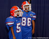 A pair of children try on helmets and shoulder pads during the Gators' annual Fan Day event on Saturday, August 20, 2011 at the Stephen C. O'Connell Center in Gainesville, Fla. / Gator Country photo by Tim Casey