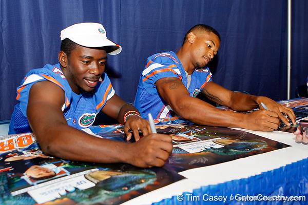 Florida sophomore receiver Robert Clark signs an autograph during the Gators' annual Fan Day event on Saturday, August 20, 2011 at the Stephen C. O'Connell Center in Gainesville, Fla. / Gator Country photo by Tim Casey