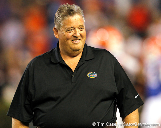 Florida offensive coordinator/quarterbacks coach Charlie Weis smiles before the Gators' 38-10 loss to the Alabama Crimson Tide on Saturday, October 1, 2011 at Ben Hill Griffin Stadium in Gainesville, Fla. / Gator Country photo by Tim Casey