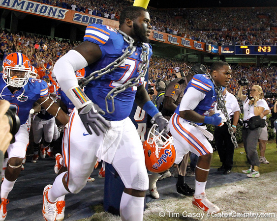 Florida sophomore defensive tackle Sharrif Floyd and sophomore defensive tackle Dominique Easley run onto the field before the Gators' 38-10 loss to the Alabama Crimson Tide on Saturday, October 1, 2011 at Ben Hill Griffin Stadium in Gainesville, Fla. / Gator Country photo by Tim Casey