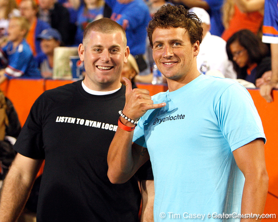 Ryan Lochte poses for a photo before the Gators' 38-10 loss to the Alabama Crimson Tide on Saturday, October 1, 2011 at Ben Hill Griffin Stadium in Gainesville, Fla. / Gator Country photo by Tim Casey