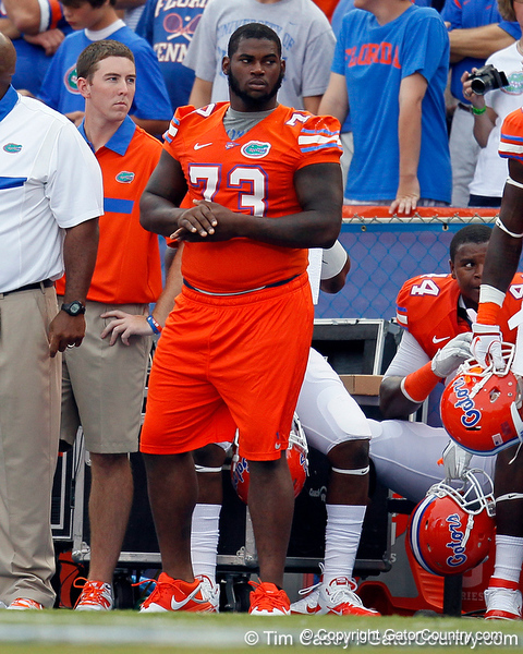 Florida sophomore defensive tackle Sharrif Floyd watches from the sideline during the first quarter of the Gators' 41-3 win against the FAU Owls on Saturday, September 3, 2011 at Ben Hill Griffin Stadium in Gainesville, Fla. / Gator Country photo by Tim Casey