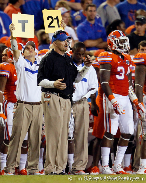 Florida defensive coordinator/defensive line coach Dan Quinn signals from the sideline during the third quarter of the Gators' 41-3 win against the FAU Owls on Saturday, September 3, 2011 at Ben Hill Griffin Stadium in Gainesville, Fla. / Gator Country photo by Tim Casey