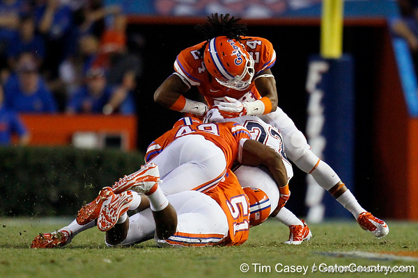Florida redshirt freshman linebacker Michael Taylor and Florida sophomore linebacker Darrin Kitchens tackle Damian Fortner at the 40-yard line during the fourth quarter of the Gators' 41-3 win against the FAU Owls on Saturday, September 3, 2011 at Ben Hill Griffin Stadium in Gainesville, Fla. / Gator Country photo by Tim Casey