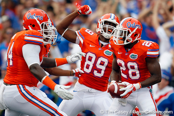 Florida redshirt sophomore receiver Stephen Alli congratulates senior running back Jeff Demps after a kickoff return during the first quarter of the Gators' 41-3 win against the FAU Owls on Saturday, September 3, 2011 at Ben Hill Griffin Stadium in Gainesville, Fla. / Gator Country photo by Tim Casey