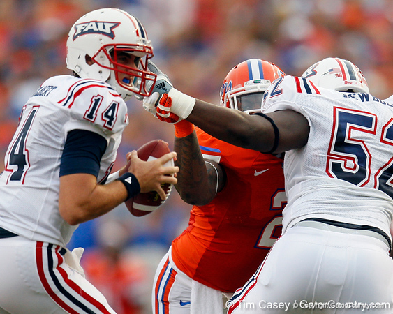 Florida sophomore defensive tackle Dominique Easley pressures the quaterback during the first quarter of the Gators' 41-3 win against the FAU Owls on Saturday, September 3, 2011 at Ben Hill Griffin Stadium in Gainesville, Fla. / Gator Country photo by Tim Casey