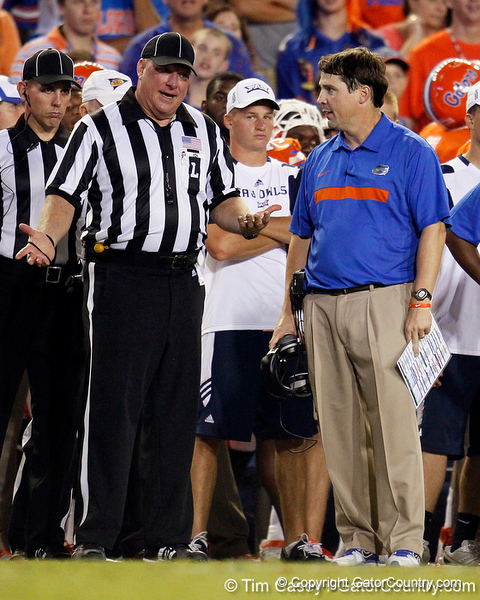 Florida head coach Will Muschamp talks with line judge Paul Petrisko during the third quarter of the Gators' 41-3 win against the FAU Owls on Saturday, September 3, 2011 at Ben Hill Griffin Stadium in Gainesville, Fla. / Gator Country photo by Tim Casey