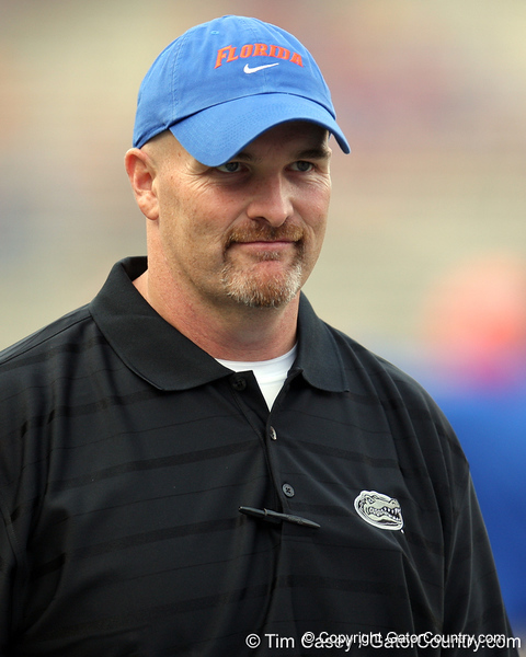 Florida defensive coordinator/defensive line coach Dan Quinn oversees warmups before the Gators' 41-3 win against the FAU Owls on Saturday, September 3, 2011 at Ben Hill Griffin Stadium in Gainesville, Fla. / Gator Country photo by Tim Casey