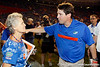 Florida head coach Will Muschamp hugs his mother after the Gators' 41-3 win against the FAU Owls on Saturday, September 3, 2011 at Ben Hill Griffin Stadium in Gainesville, Fla. / Gator Country photo by Tim Casey