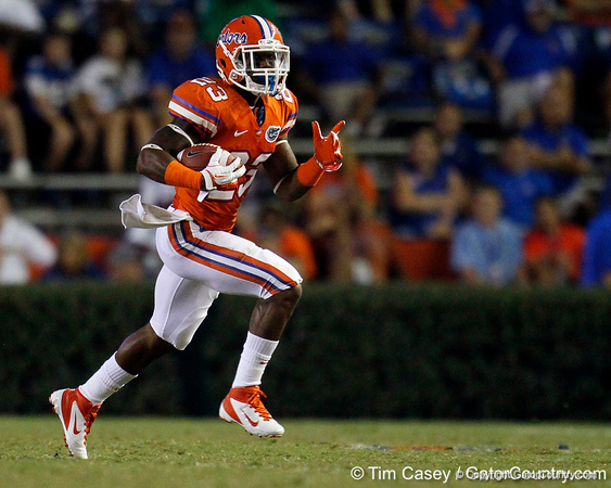 Florida junior running back Mike Gillislee runs seven yards to the 50-yard line during the fourth quarter of the Gators' 41-3 win against the FAU Owls on Saturday, September 3, 2011 at Ben Hill Griffin Stadium in Gainesville, Fla. / Gator Country photo by Tim Casey