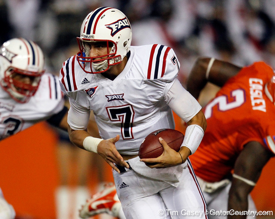 FAU quarterback David Kooi runs for a 14-yard gain during the second quarter of the Gators' 41-3 win against the FAU Owls on Saturday, September 3, 2011 at Ben Hill Griffin Stadium in Gainesville, Fla. / Gator Country photo by Tim Casey